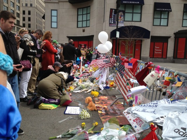Flowers and people at barricade on Boylston Street