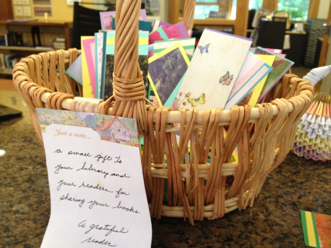 Basket of handmade bookmarks with note.