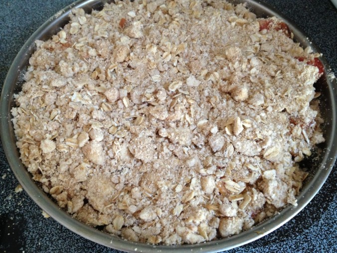Uncooked fruit crisp in round pan